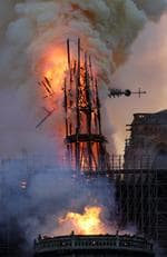 The steeple collapses as smoke and flames engulf the Notre-Dame Cathedral in Paris on April 15, 2019. (Photo by Geoffroy VAN DER HASSELT / AFP)
