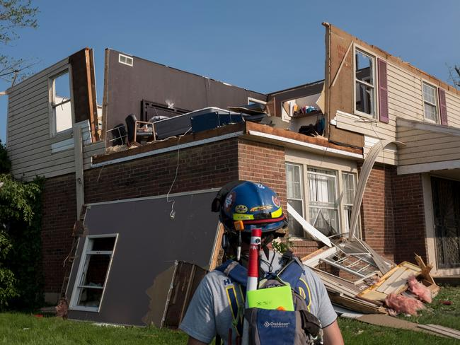 A member of search and rescue inspects a home in Trotwood, Ohio, on May 28, 2019, after powerful tornadoes ripped through the US state overnight. Picture: AFP