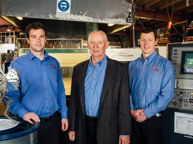 Ron Thomson and his sons, Lawrence, left, and Muir, who run Laser Wizard Sydney at their St Mary's factory / Picture: Jonathan Ng