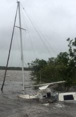 Cyclone Debbie - Twitter user Ange_Nixon posted this image of a yacht at Eimeo Creek near Mackay. Picture: Ange_Nixon/Twitter