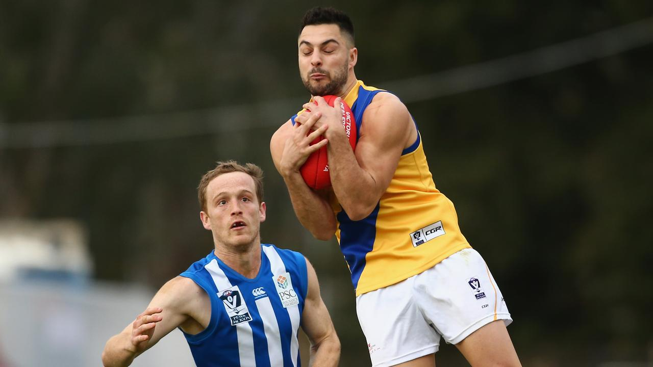 MELBOURNE, AUSTRALIA — AUGUST 04: Michael Gibbons of Williamstown marks the ball during the round 18 VFL match between North Melbourne and Williamstown at Avalon Airport Oval on August 4, 2018 in Melbourne, Australia. (Photo by Mike Owen/AFL Media/Getty Images)