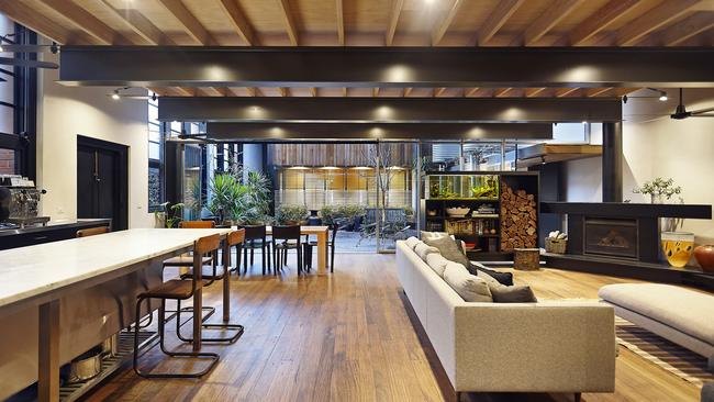 Inside the home's open-plan living, dining and kitchen area.