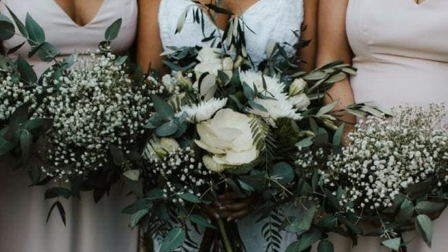 Dani paid for her bouquet to be made, but the bridesmaids pulled together their own bouquets. A lot of the flowers came from Dani and Chris' garden. Picture: Bulb Creative