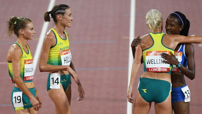 Celia Sullohern, Madeline Hills and Eloise Wellings of Australia congratulate Lineo Chaka of Lesotho. Picture: AAP