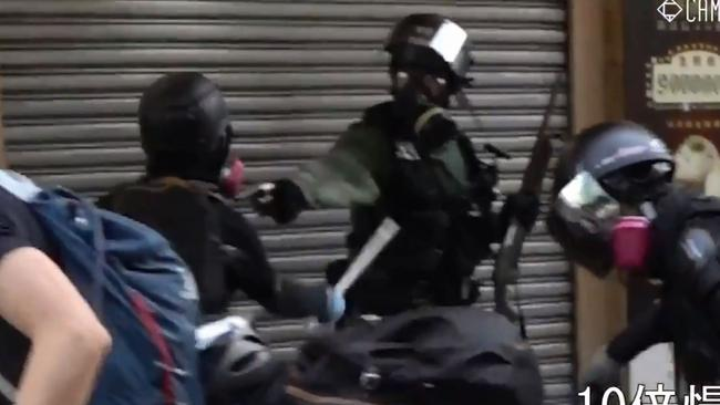 A still from a video filmed in Hong Kong that appears to show a protester being shot by local police. Picture: Campus TV.