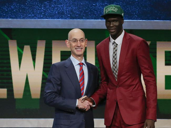 Thon Maker, right, poses for a photo with NBA Commissioner Adam Silver.