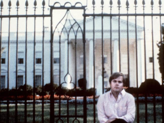 March 01, 1981: John Hinckley in front of the White House in Washington, DC.