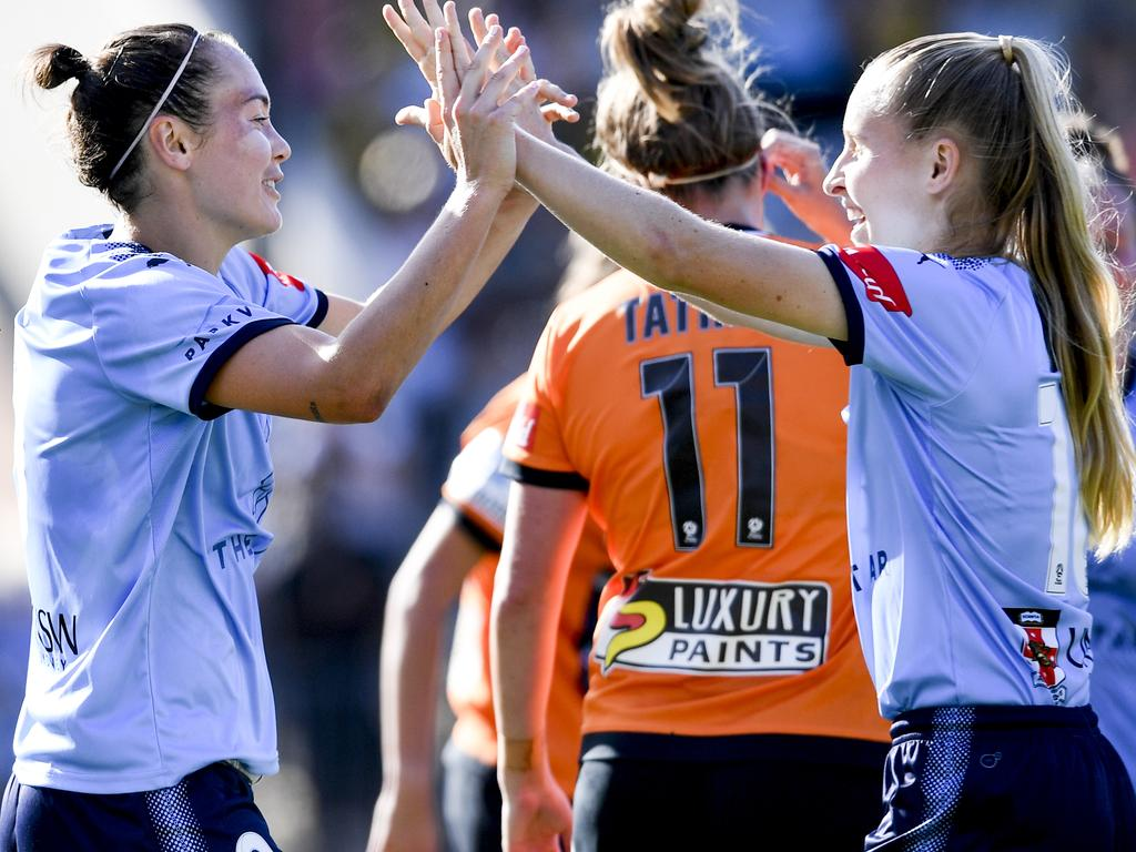 Caitlin Foord (left) of Sydney reacts after scoring against the roar during the Round 6 W-League match between Sydney FC and Brisbane Roar at Seymour Shaw Park in Sydney, Sunday, December 9, 2018. (AAP Image/Brendan Esposito) NO ARCHIVING, EDITORIAL USE ONLY