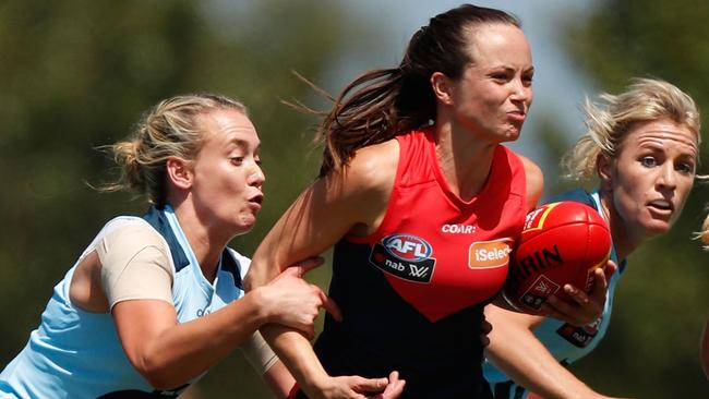 Daisy Pearce of the Demons is tackled by Lauren Arnell of the Blues. (Photo by Michael Willson/AFL Media/Getty Images)
