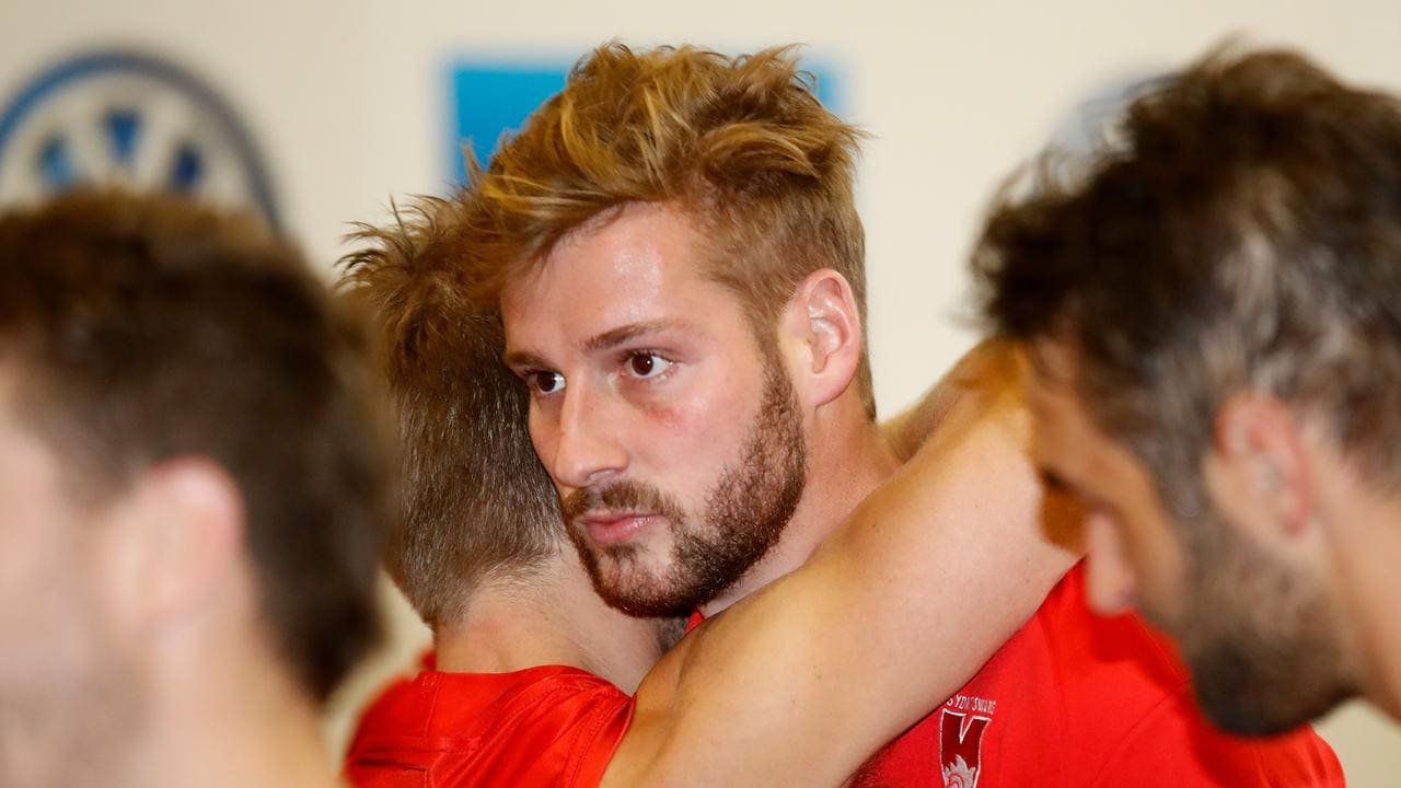 Alex Johnson looks on after rupturing his ACL against Melbourne. Photo: Michael Willson/AFL Media.