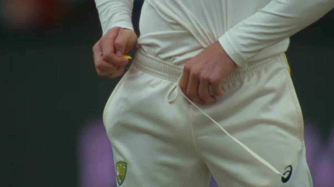TV cameras capture Cameron Bancroft trying to hide the sandpaper in his cricket pants.