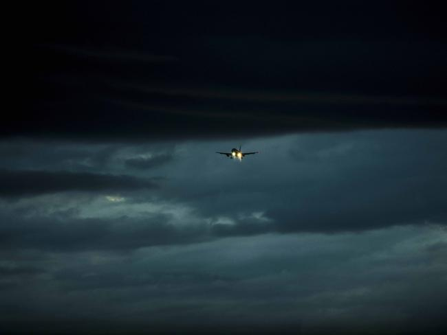 A plane lands during the storm. Picture: Darren Leigh Roberts