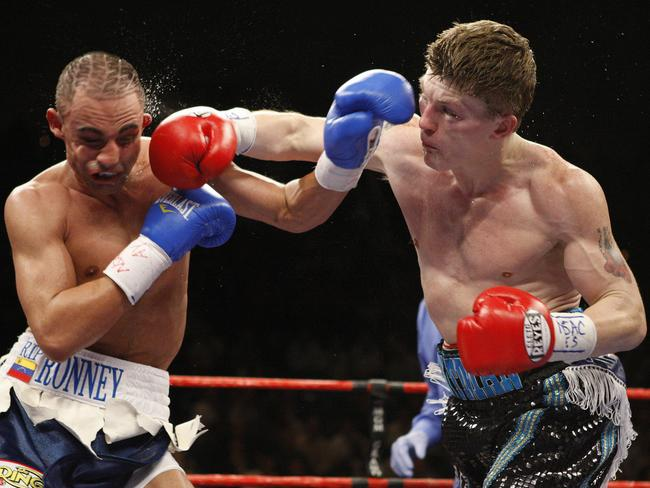 Paulie Malignaggi (L) cops a right hand from Ricky Hatton.