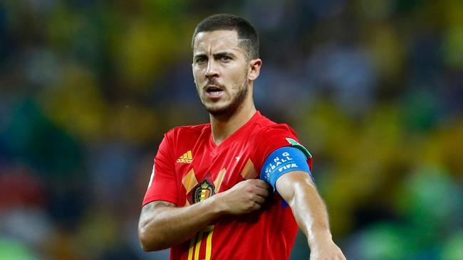 Belgium forward Eden Hazard adjusts his captain's armband.