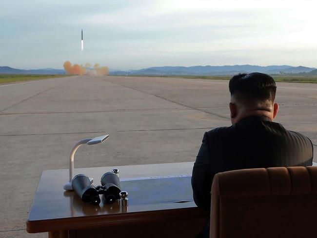 North Korean leader Kim Jong-un inspecting a launching drill of the medium-and-long range strategic ballistic rocket Hwasong-12 at an undisclosed location. Picture: KCNA/AFP