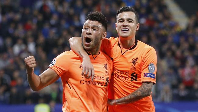 Liverpool's Alex Oxlade-Chamberlain (L) celebrates with Philippe Coutinho after scoring.