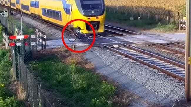 The nose of the train narrowly misses the cyclist. Picture: ProRail/Youtube