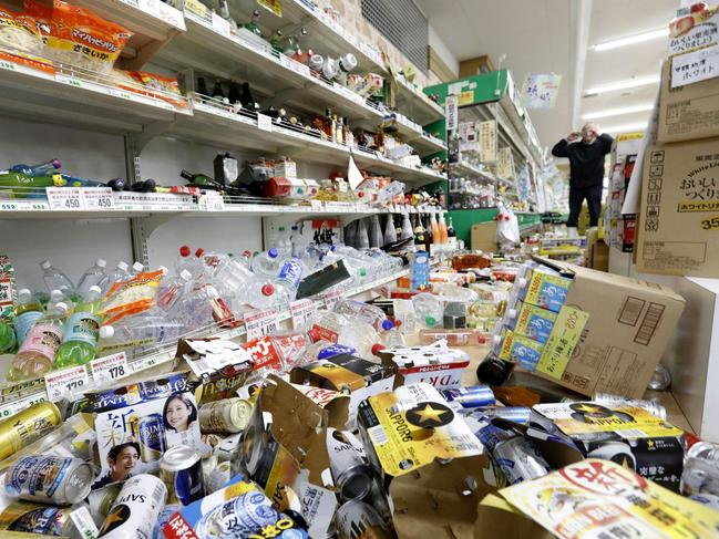 Cans and other items are scattered on the floor of a supermarket following the earthquake. Picture: AP
