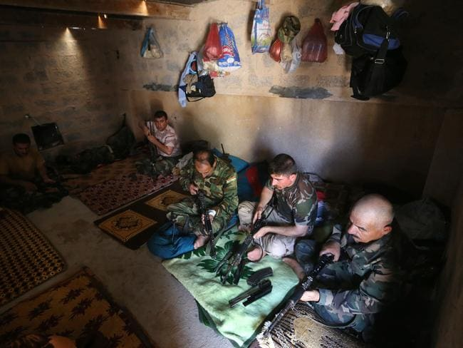 Taking up arms...ex-diggers are wanting to join Kurdish fighters like the ones pictured in the fight against the Islamic State. Picture:AP/Hussein Malla