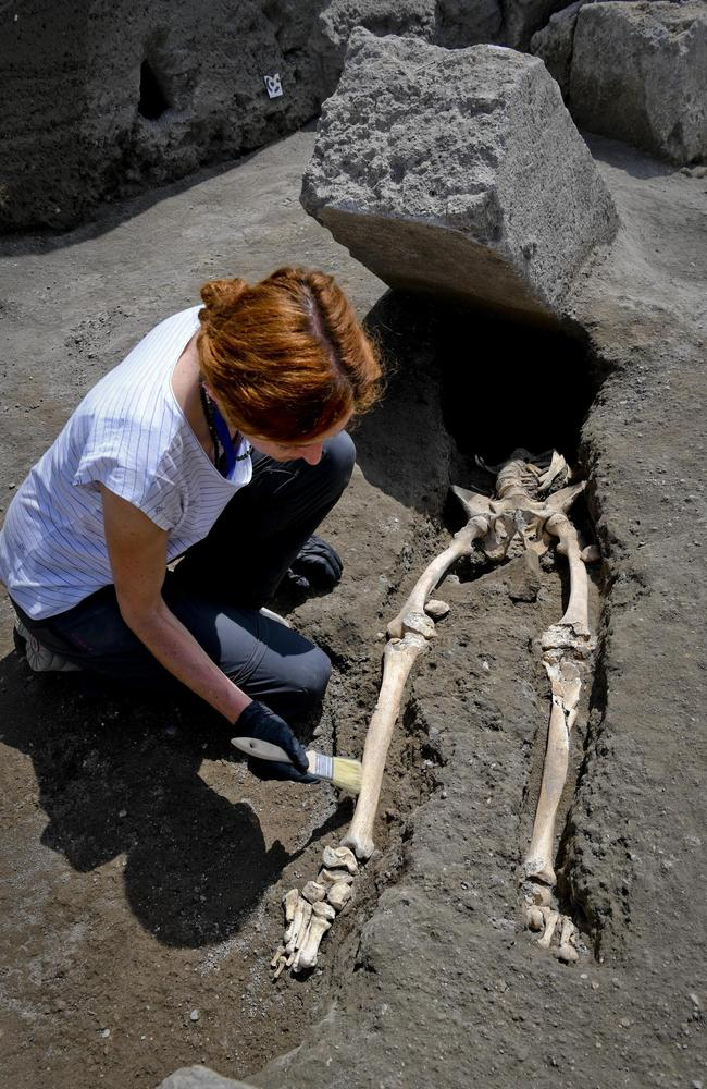 Anthropologist Valeria Amoretti carefully uncovers the skeleton of a victim of the eruption of Mt. Vesuvius in A.D. 79, which destroyed the ancient town of Pompeii. Picture: Ciro Fusco/ANSA via AP