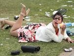 MELBOURNE, AUSTRALIA - NOVEMBER 01: A racegoers falls over following 2016 Melbourne Cup Day at Flemington Racecourse on November 1, 2016 in Melbourne, Australia. (Photo by Scott Barbour/Getty Images)
