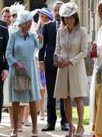 Camilla, Duchess of Cornwall and Carole Middleton leave the Church of St Mary Magdalene on the Sandringham Estate for the Christening of Princess Charlotte of Cambridge on July 5, 2015 in King's Lynn, England. Picture: Getty