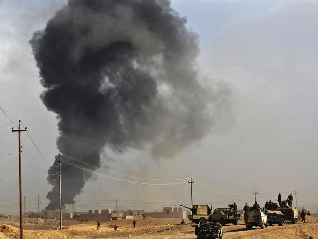 Iraqi forces and members advance towards the city of al-Qaim. Picture: AFP