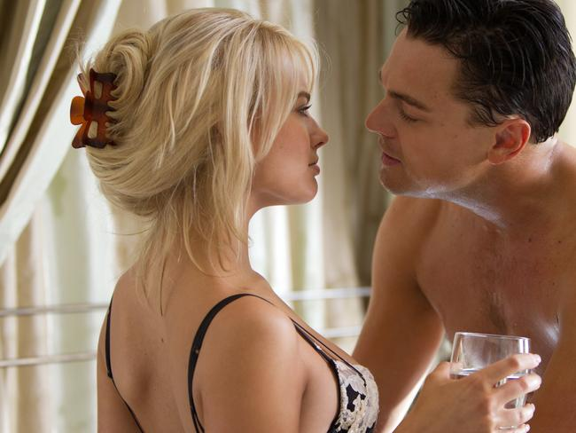 Margot Robbie with Leonardo DiCaprio in a scene from The Wolf of Wall Street.