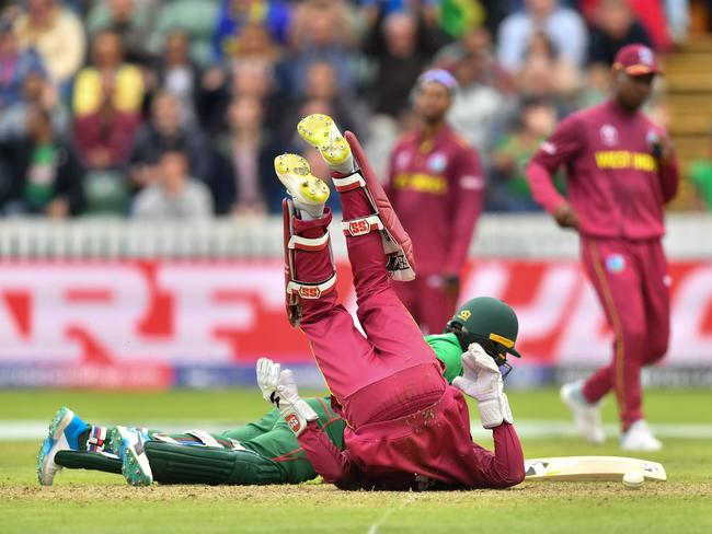 Bangladesh's Liton Das and West Indies' Shai Hope collide in an unsuccessful attempted run out. Picture: Saeed Khan/AFP