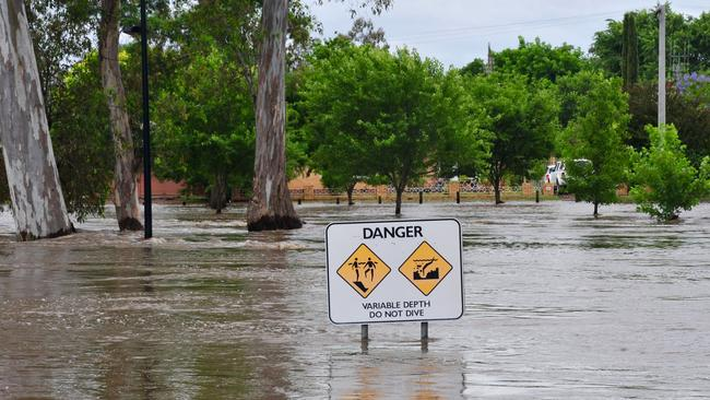 Floodwaters reach the top of a sign in Euroa, Victoria, on Saturday. Picture: AAP Image/Brendan McCarthy.