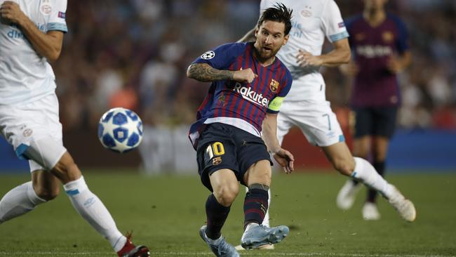 Barcelona forward Lionel Messi takes a shot against PSV Eindhoven. Picture: AP