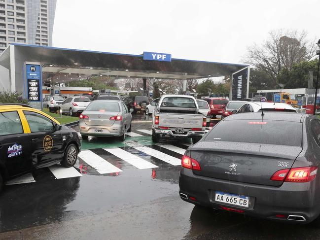Cars wait in line at a petrol station in Buenos Aires, Argentina, during the power outage. Picture: AFP