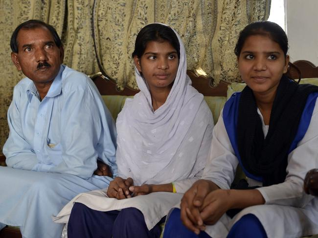Ashiq Masih, the husband of Asia Bibi and their daughters Esham (right) and Esha (centre) are fighting for Asia Bibi to be free.