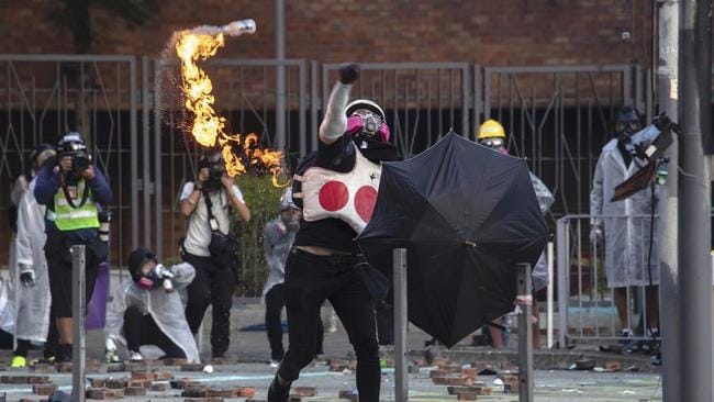 A protester throws a molotov cocktail during a confrontation with police at Hong Kong Polytechnic University in Hong Kong. Picture: AP/Ng Han Guan