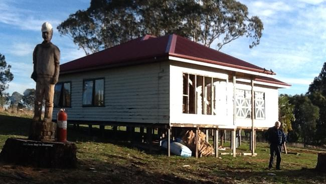The Castle house has been partially rebuilt in Beechworth, as Mr Fendyk prepares to fight the local council over his caravan park plans.
