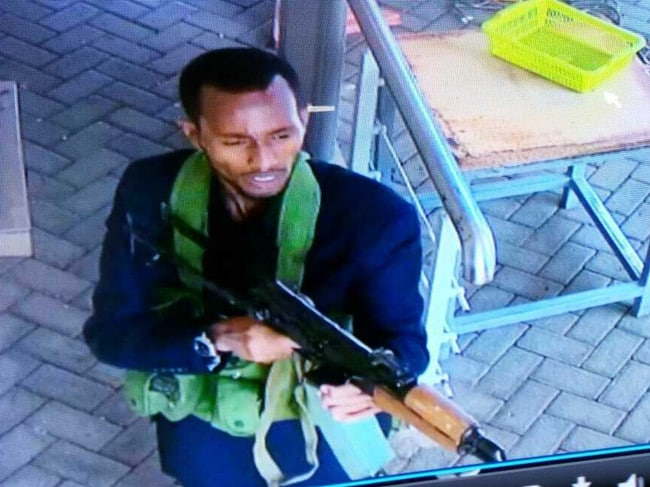In this still taken from security camera footage an armed attacker walks in the compound of the hotel. Picture: AP