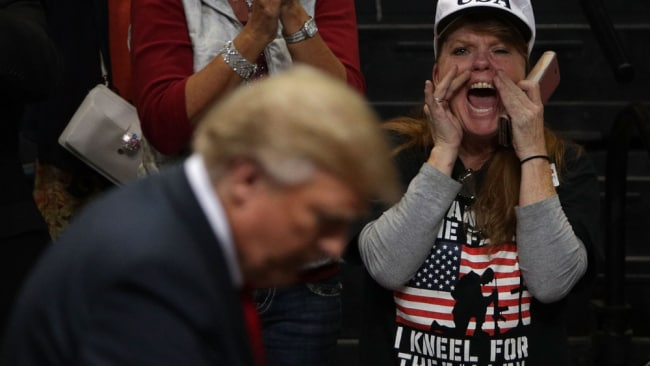 A female protestor is revolted by Trump. Source: Getty