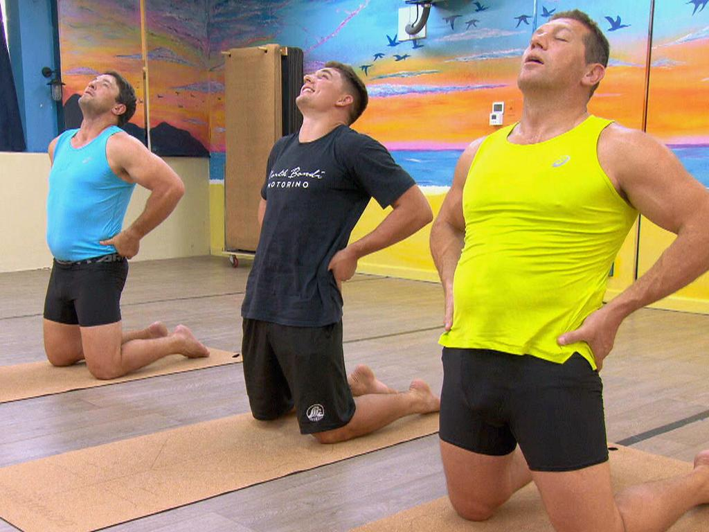 Victor Radley takes part in a bikram yoga session with Bryan Fletcher and Nathan Hindmarsh.