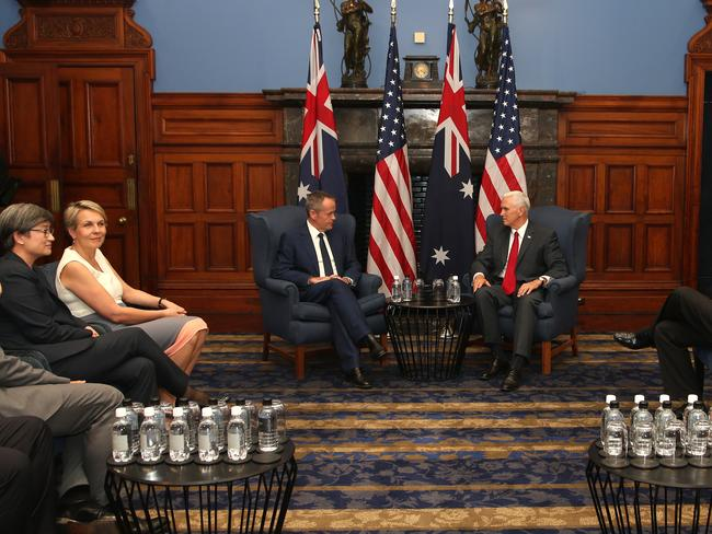 Mike Pence (right) meets with the Opposition Leader Bill Shorten (centre left) on Saturday. Picture: Rick Rycroft-Pool/Getty Images