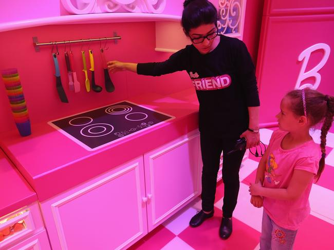 Lina, 7, gets a tour of the kitchen at the Barbie Dreamhouse Experience in Berlin, Germany. The Barbie Dreamhouse is a life-size house full of Barbie fashion, furniture and accessories. Picture: Sean Gallup/Getty Images.