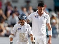LEEDS, ENGLAND - AUGUST 04: James Taylor of England is consoled by Kevin Pietersen of England after his dismissal during day 3 of the 2nd Investec Test Match between England and South Africa at Headingley on August 4, 2012 in Leeds, England. (Photo by Tom Shaw/Getty Images)