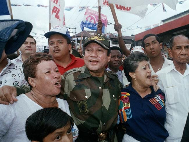 Noriega walks with supporters in Panama City in 1988. Picture: AP / John Hopper