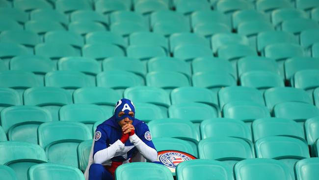 Even Super Heroes have bad days. A fan dressed as Captain America takes a moment after the game.