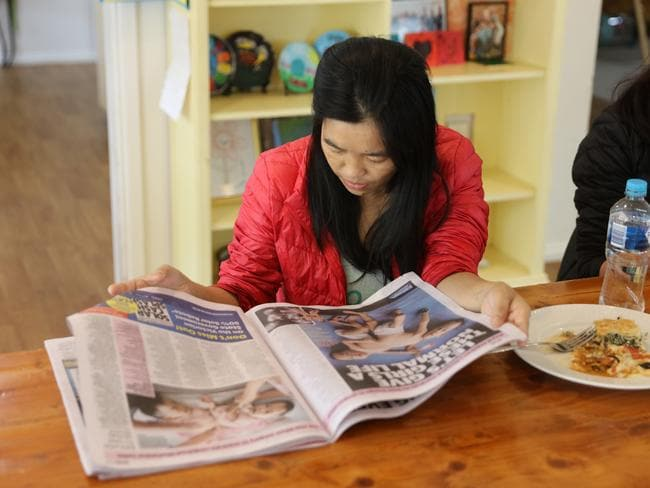 Bhumchu Zangmo reads the  <i>Herald Sun</i> at the Children First Foundation Miracle Smiles Retreat in Kilmore. Picture: Alex Coppel