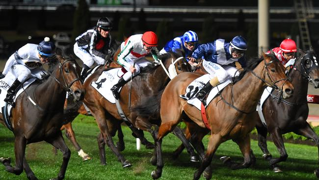 Viddora (right, blue and white silks) is narrowly beaten by She Will Reign in the Moir Stakes at Moonee Valley. Picture: Getty Images