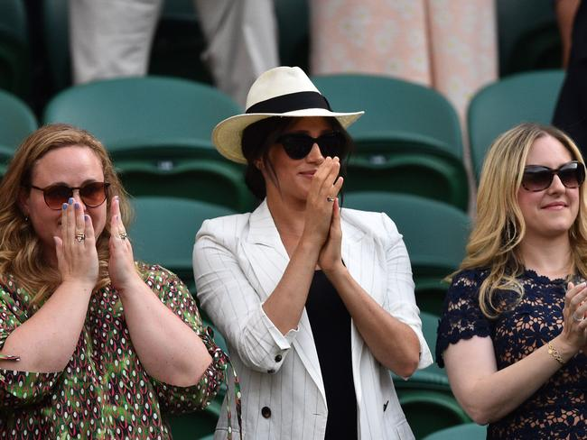 Meghan and her mates at Wimbledon. Picture: Glyn KIRK / AFP