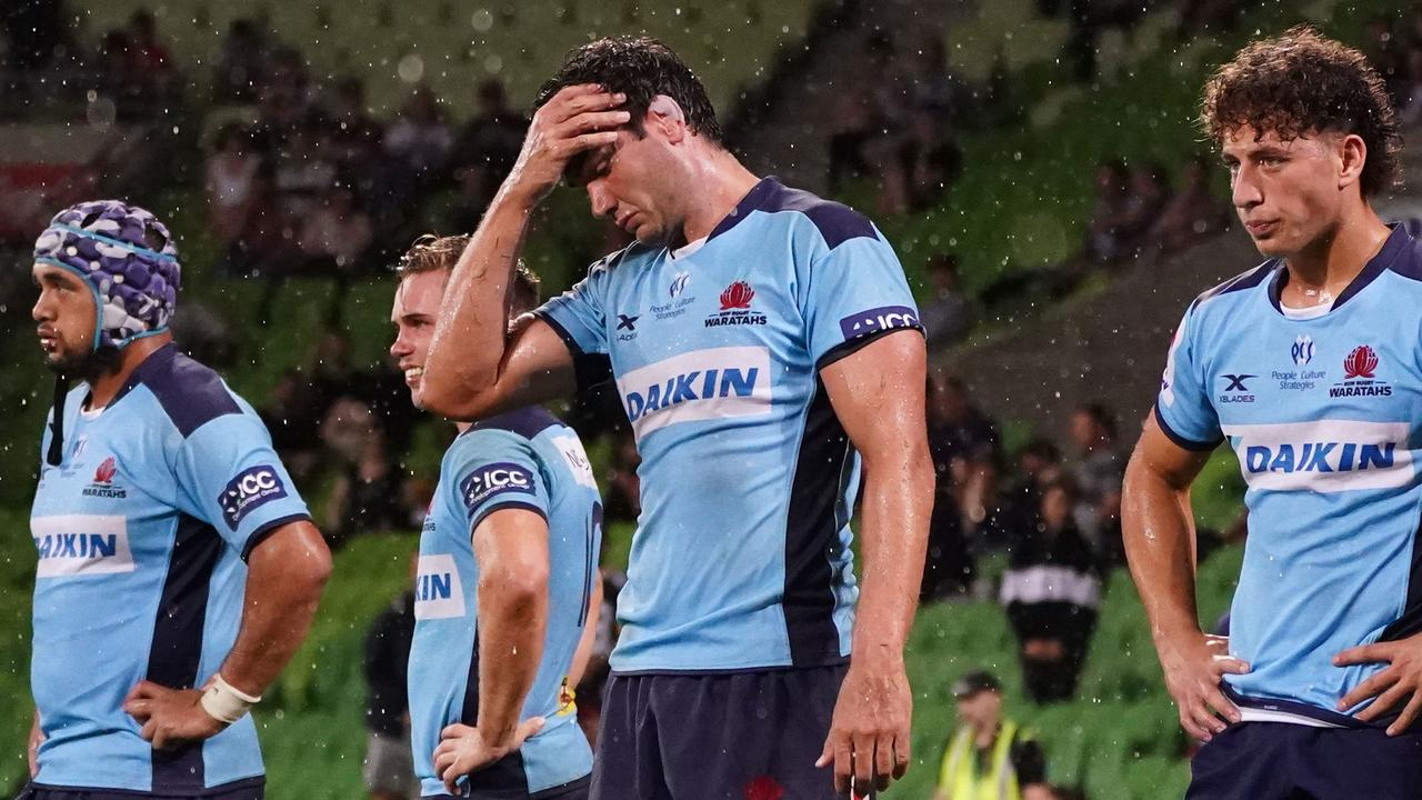 Rob Simmons and Waratahs players look on following a Rebels try at AAMI Park.