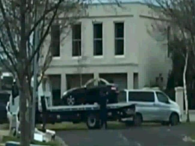 Police tow Karen Ristevski's black Mercedes-Benz from the Avondale Heights home she shared with her husband Borce and their daughter Sarah. Picture: Channel 7