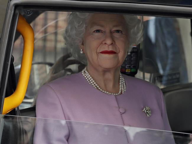 A mannequin in the likeness of the Queen is driven in a black cab past the Lindo wing at St Mary's Hospital in London after the birth. Picture: AP Photo/Kirsty Wigglesworth