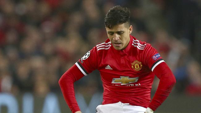 Manchester United's Alexis Sanchez, reacts after United miss a chance to score